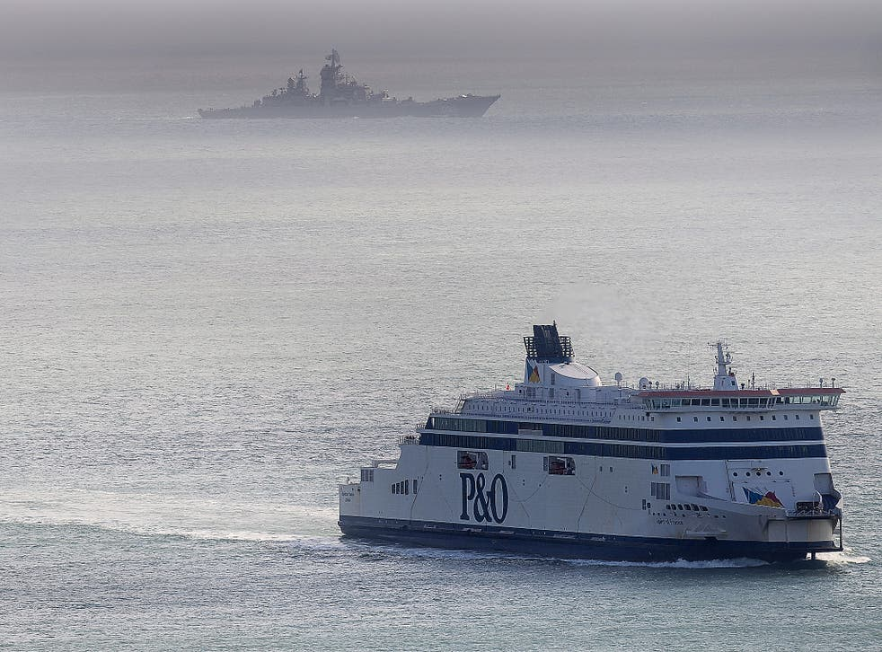 A Russian naval vessel passes a ferry in the English Channel last week