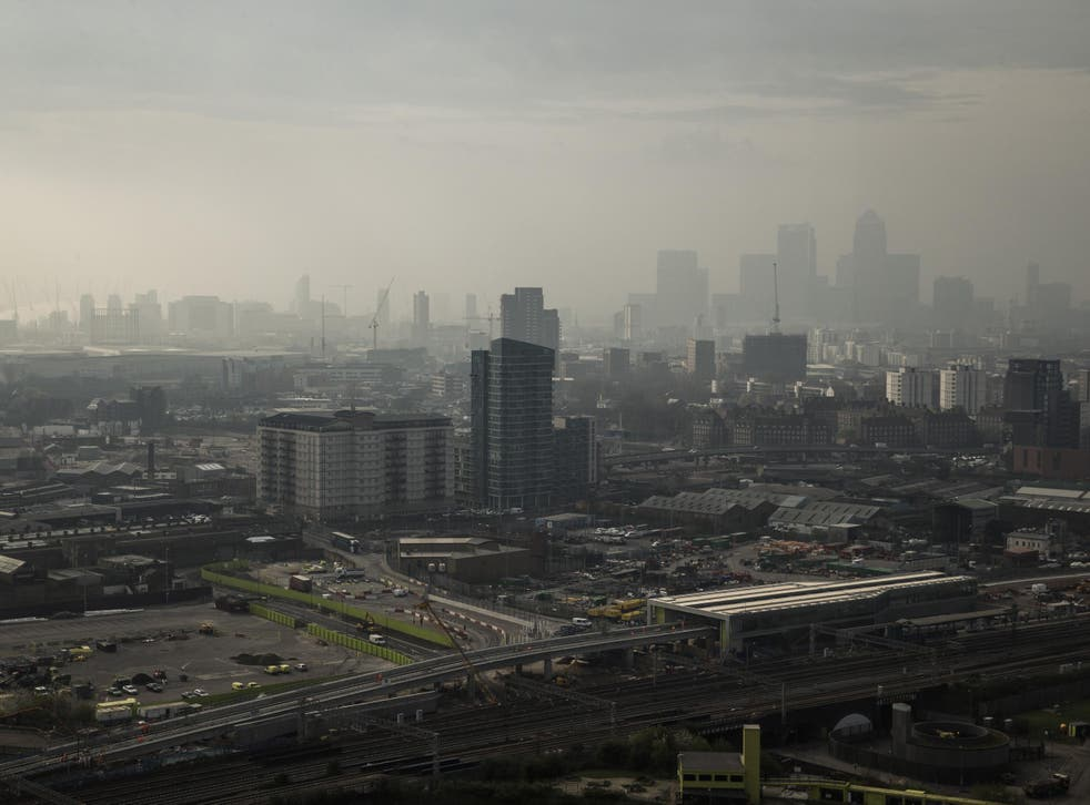 Canary Wharf in London is shrouded by smog