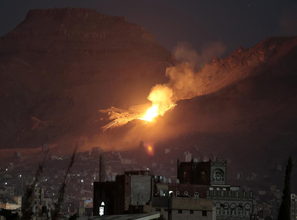 Fire and smoke rise after a Saudi-led air strike hit a weapons depot on the outskirts of Yemen's capital, Sana'a in October