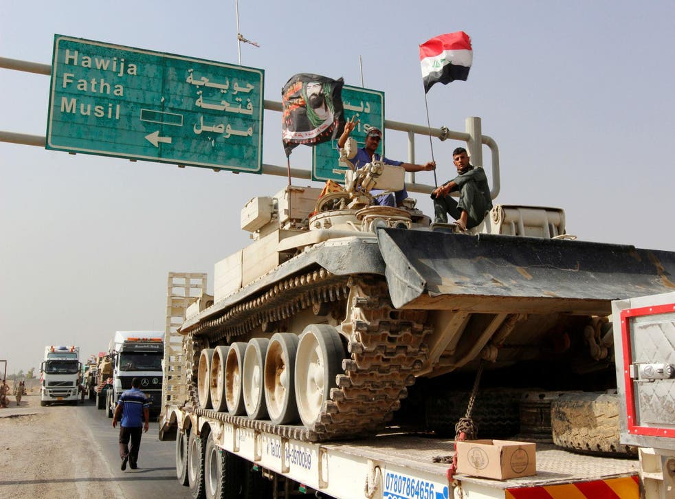 A convoy of Iraqi forces advances on Mosul in the days before the offensive was launched against the Isis-held city