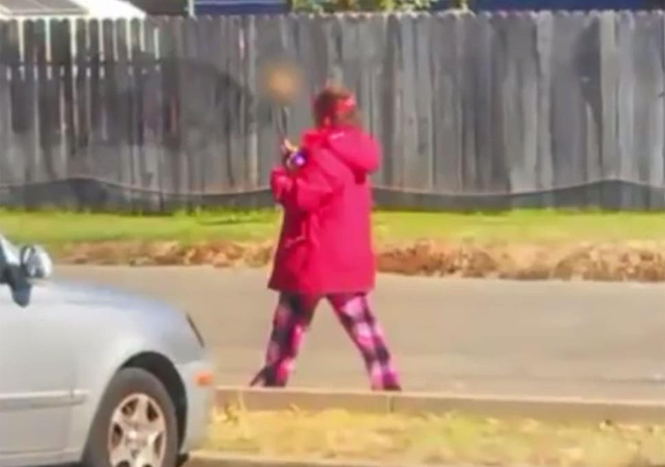 Woman found walking around with human skull on a stick shows
