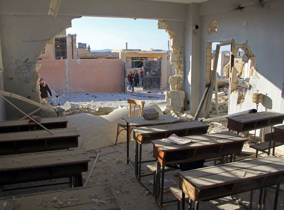 A damaged classroom at a school hit in an air strike in the village of Hass, in the south of Syria's rebel-held Idlib province on October 26, 2016