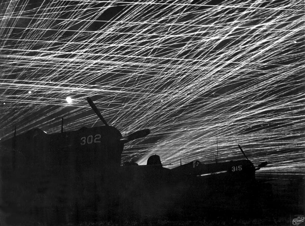 Japanese night raiders are greeted with a flak of anti-aircraft fire by the Marine defenders of Yontan airfield, on Okinawa, 1945