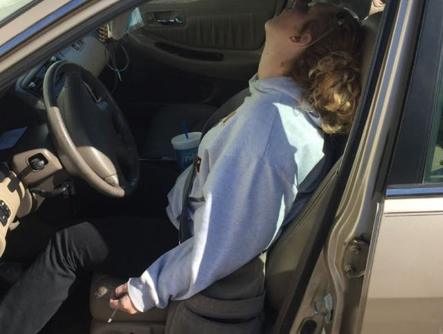 Erika Hurt pictured with a syringe still in her hand after overdosing with her son in the backseat