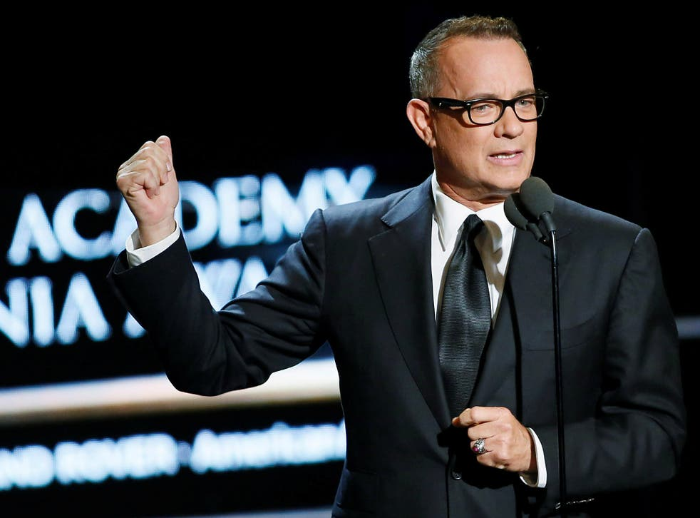 Actor Tom Hanks presents actress Felicity Jones the British Artist of the year award at the British Academy of Film and Television Arts (BAFTA Awards in Beverly Hills, California