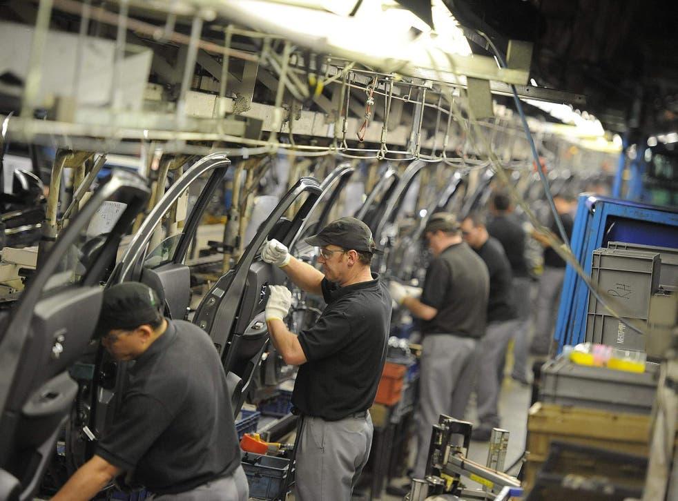Technicians prepare doors at the company's northeast plant