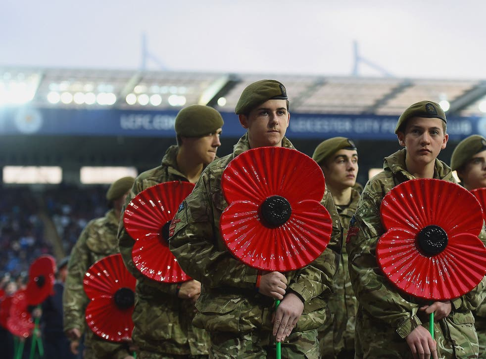The FA is in discussions with Fifa in an effort to allow both England and Scotland players to wear poppies on their shirts when they play each other at Wembley on Armistice Day