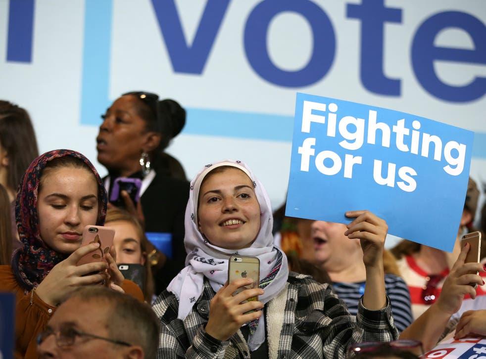 American-Muslim women listen to Democratic presidential nominee Hillary Clinton speak at a voter registration rally at Wayne State University in Detroit, Michigan