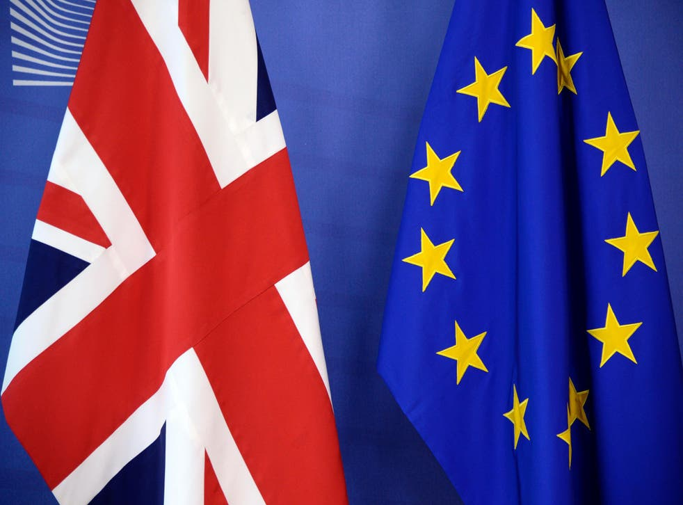 The British flag and the European Union flag are displayed at the European Union Commission headquarters in Brussels