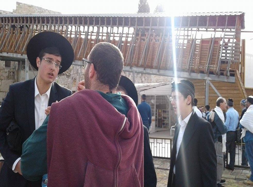 Elyahu Lopianski, left, says female rabbis should never be allowed to pray at the Western Wall