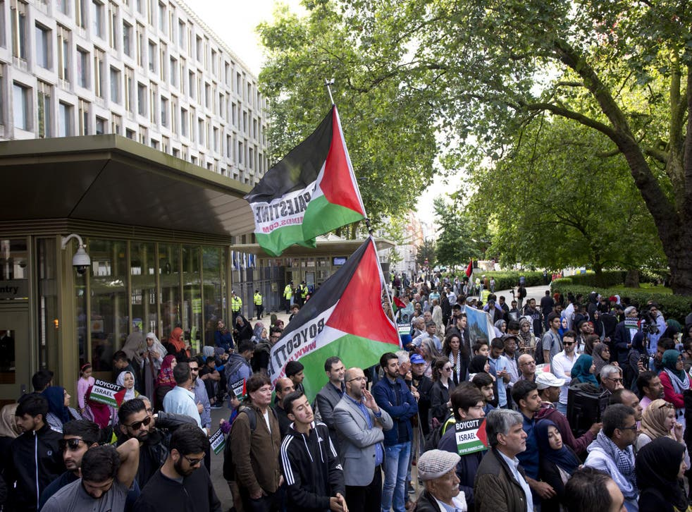 Pro-Palestinian BDS movement supporters take part in a rally in central London