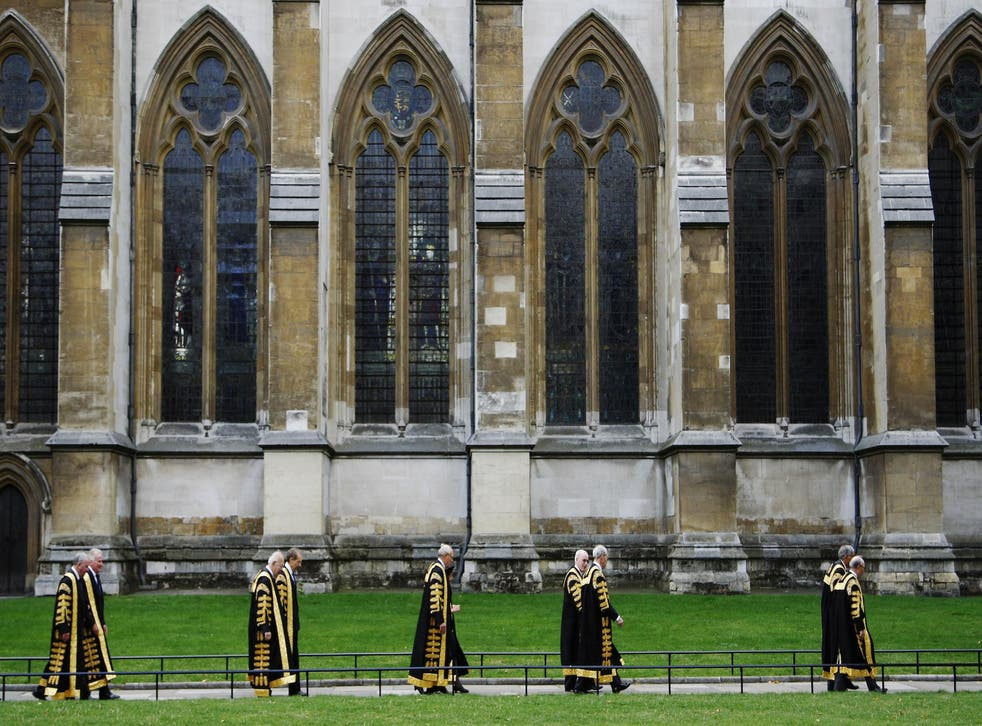 Justices of the Supreme Court of the United Kingdom arrive at Westminster Abbey after being sworn in at the Middlesex Guildhall in Parliament Square in London