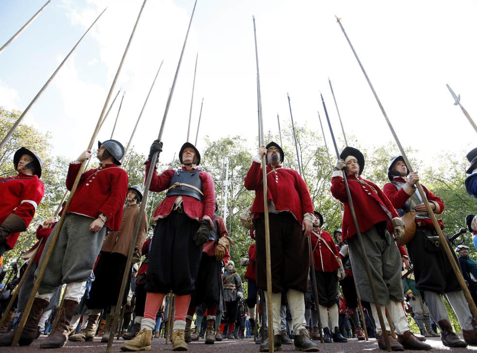 Members of the English Civil War Society hold their pikes after parading down the Mall in London