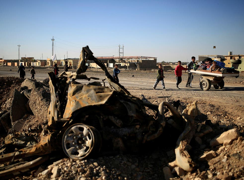 The remains of a car bomb in east Mosul on Thursday, where local resistance units are reportedly ambushing and assassinating Isis officials