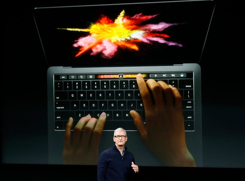 Apple chief executive Tim Cook unveils the latest Macbook Pro range during an event at the Apple Headquarters in Cupertino, California