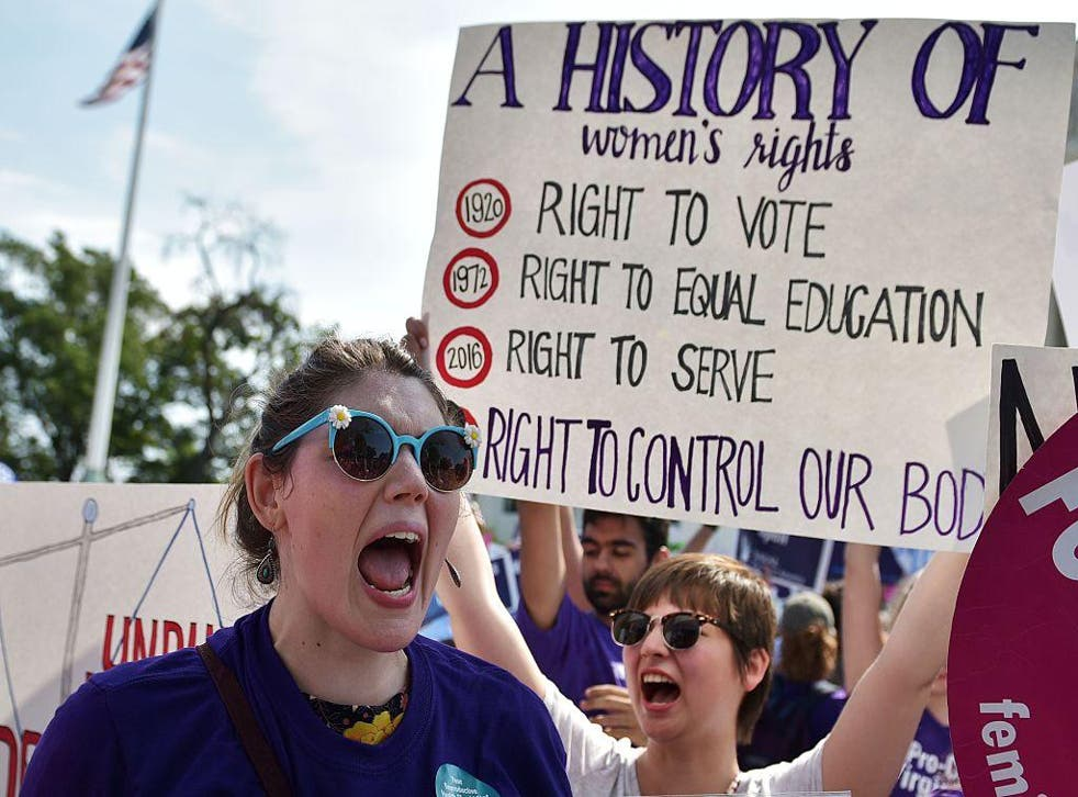 Abortion rights activists cheer after the US Supreme Court struck down a Texas law placing restrictions on abortion clinics