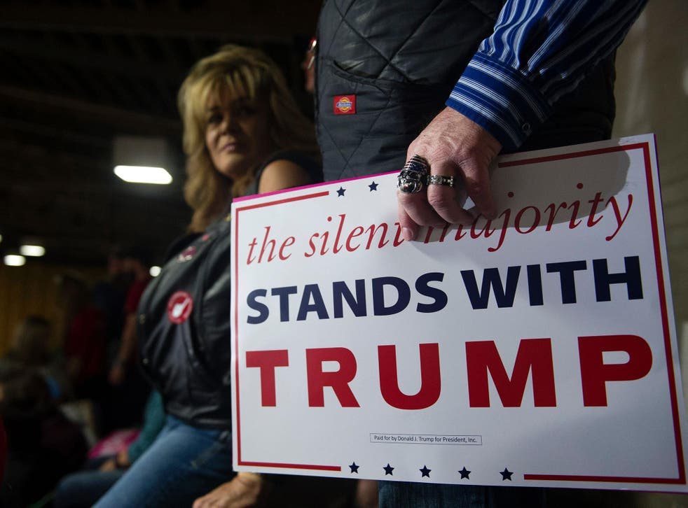 A supporter of Trump, wearing a US flag ring, listens as Trump addresses a capacity crowd at the National Western Complex in Denver, Colorado