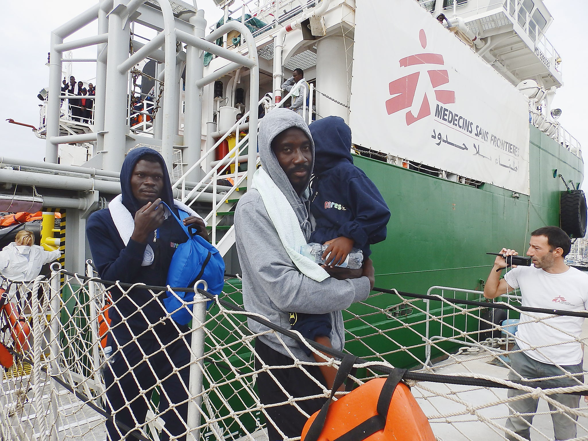 Italy threatens to close ports to humanitarian refugee rescue ships as it reaches saturation point the independent