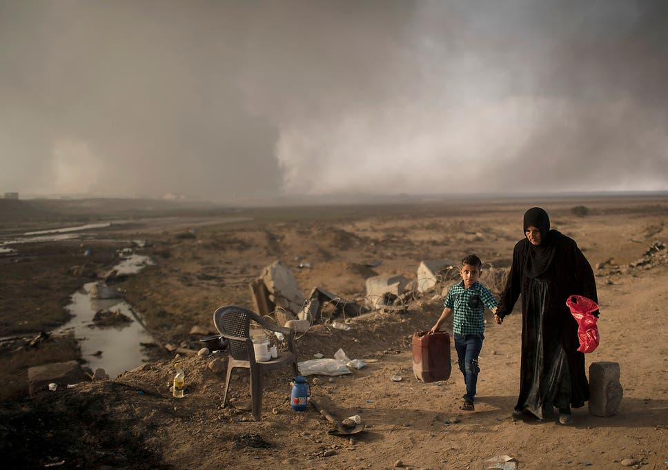 Mosul: Isis shoots dead 40 civilians and 'hangs bodies from