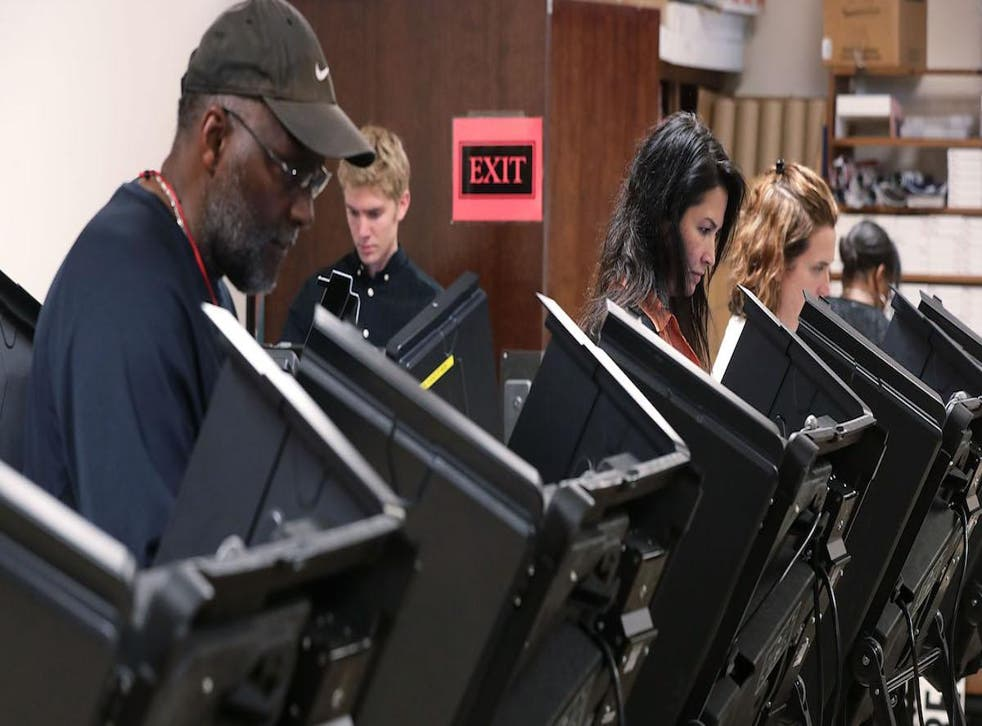 Voters cast their ballots during early voting for the 2016 general election at Forsyth County Government Center October 28, 2016 in Winston-Salem, North Carolina. Early voting has begun in North Carolina through November 5.