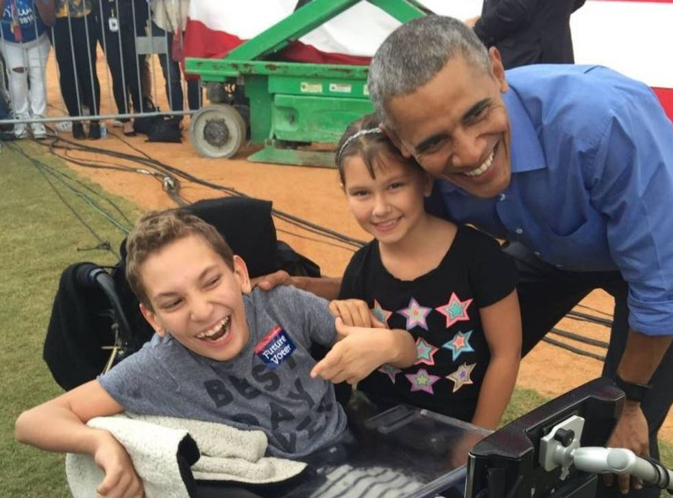 JJ Holmes with his sister, Grace, and President Obama