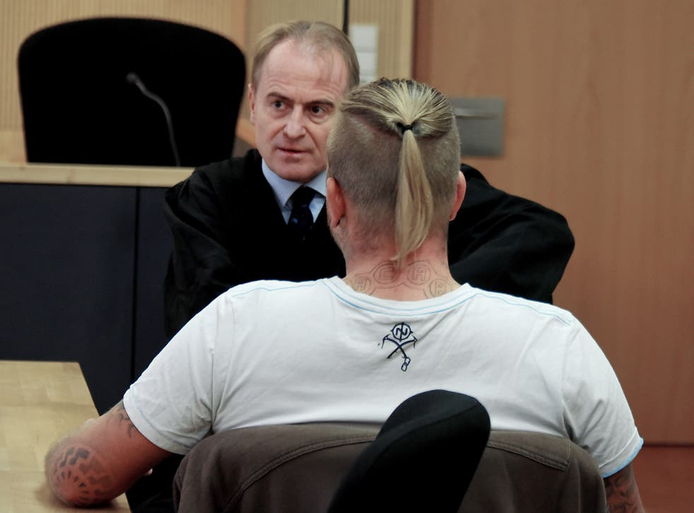 Far-right politician Marcel Zech is waiting for the beginning of the appeal case with his lawyer Wolfram Nahrath, rear, at a courtroom in Neuruppin, Germany