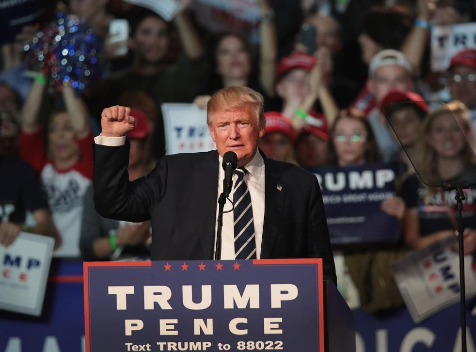 Republican presidential nominee Donald Trump addresses supporters during a campaign rally on 8 November, 2016 in Grand Rapids, Michigan