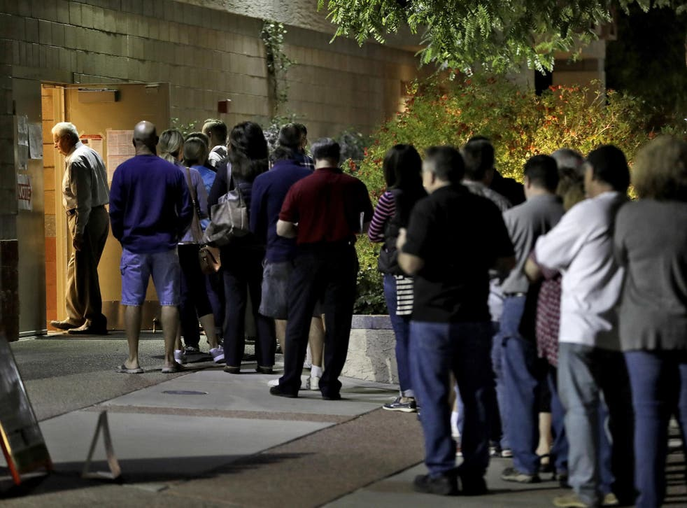 Voters in Phoenix, Arizona wait in line to vote early on election day