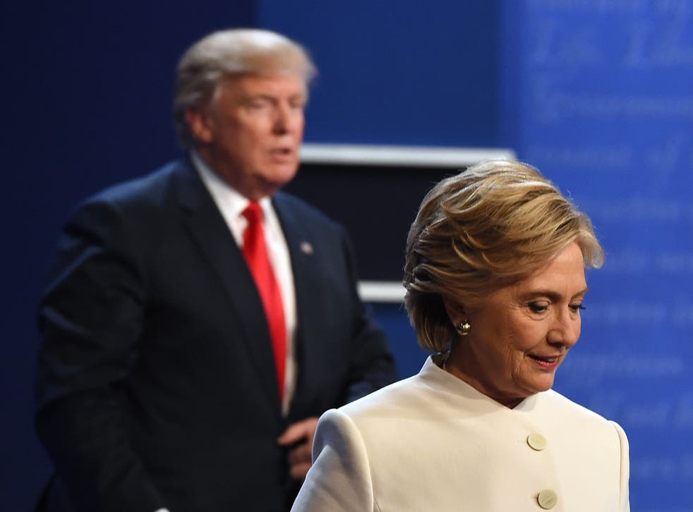 Donald Trump and Hillary Clinton leave the stage after the final presidential debate on 19 October