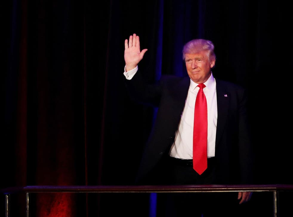 Trump waves to his supporters after Vice President-elect Mike Pence introduces him <em>Getty</em>