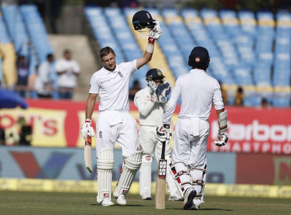 Joe Root salutes the crowd after reaching his century on day one of the first Test between India and England