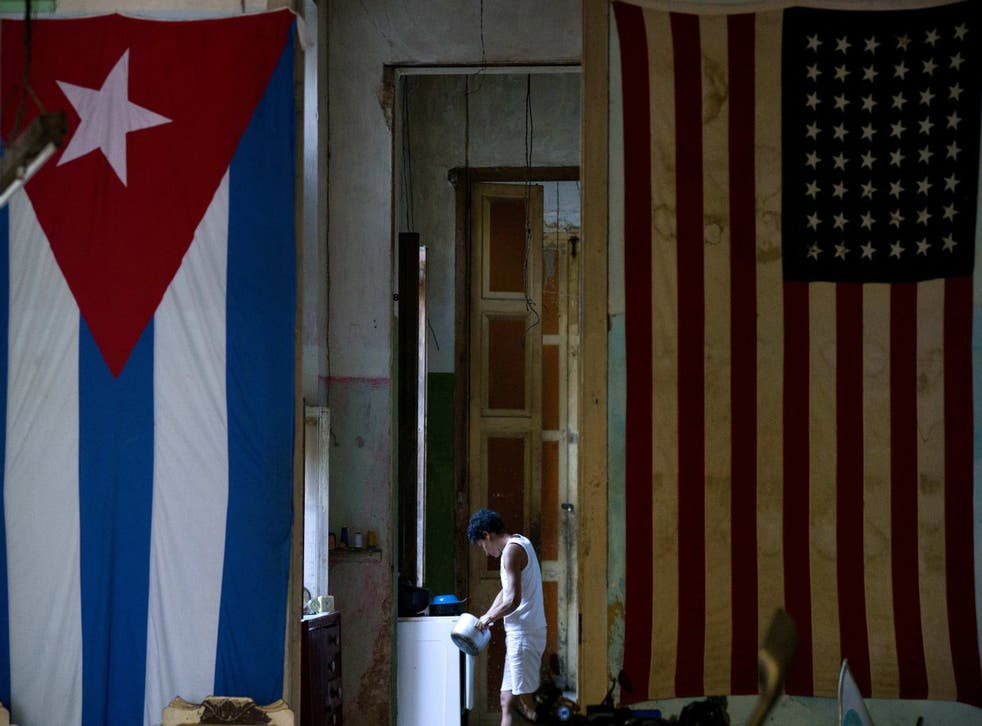 A US flag and a Cuban flag hang side by side