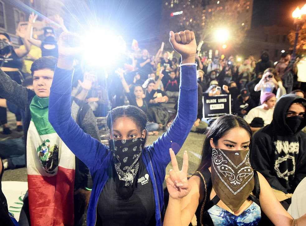 Demonstrators rally following the election of Republican Donald Trump as President of the United States, in Oakland, California
