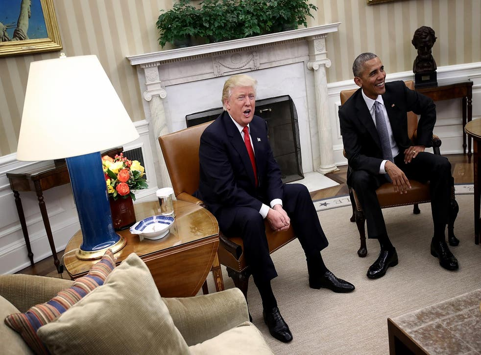 Donald Trump and Barack Obama enjoy a light-hearted exchange with journalists in the White House in December