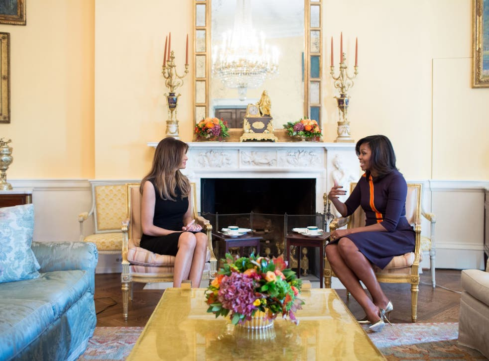 First Lady Michelle Obama meets with Melania Trump for tea in the Yellow Oval Room of the White House on November 10