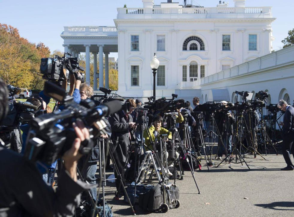 Members of the press await the arrival of US President-elect Donald Trump for a meeting with US President Barack Obama at the White House