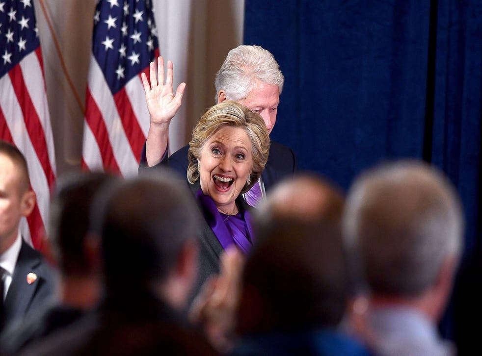 US Democratic presidential candidate Hillary Clinton is accompanied by her husband and former president Bill Clinton as she arrives to make a concession speech after being defeated by Republican president-elect Donald Trump, in New York on November 9, 201