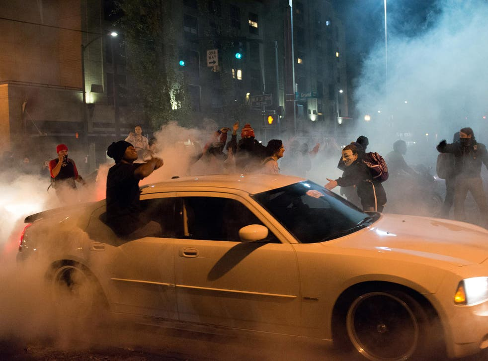 A demonstrator performs a burnout during a protest against the election of Republican Donald Trump as President of the United States in Portland, Oregon,