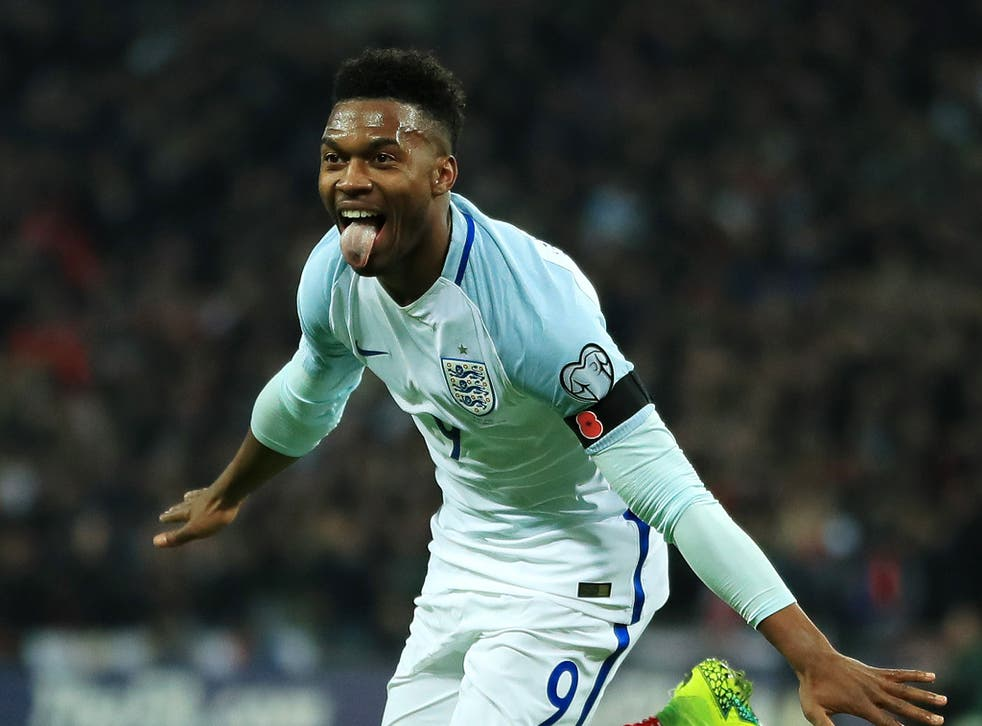 Sturridge celebrates opening the scoring at Wembley with a flicked header