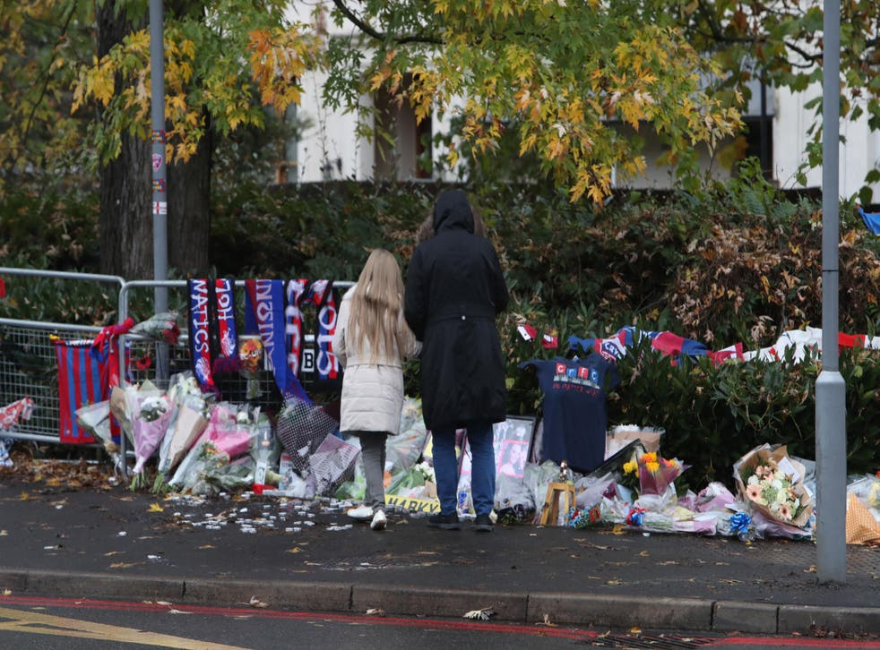 People pay tribute to victims of the tram crash near the scene where a tram crashed