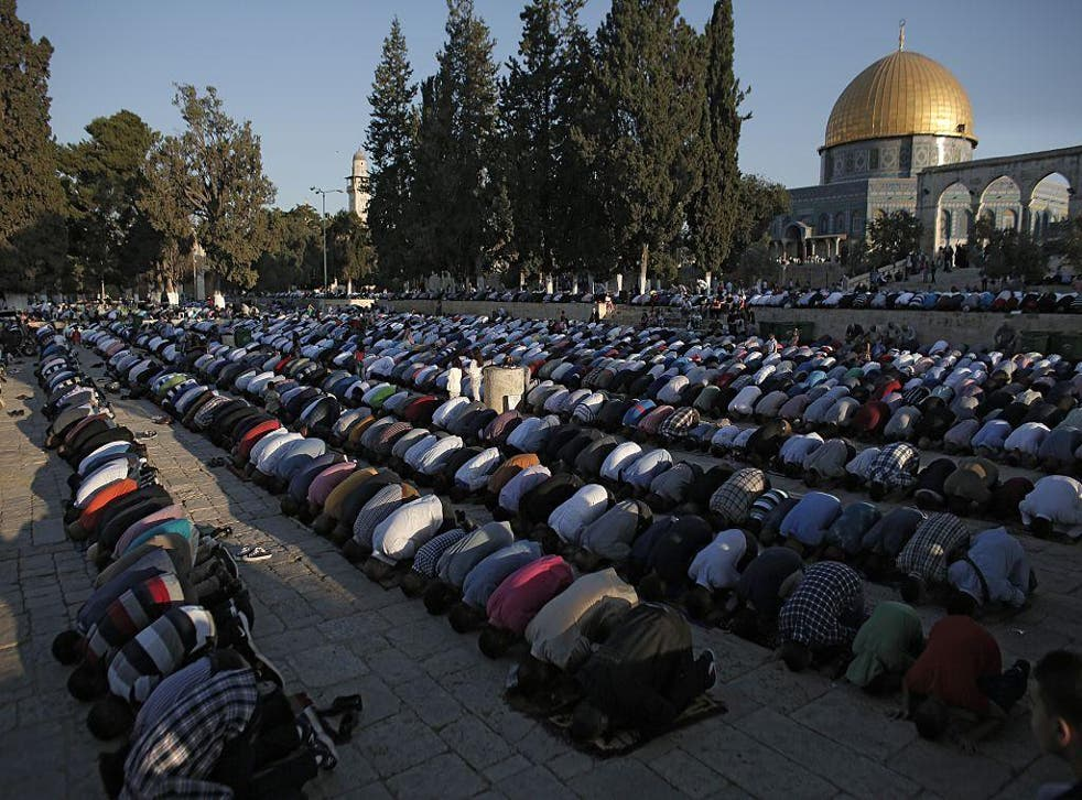 Palestinian Muslim worshippers praying at the al-Aqsa Mosque compound in Jerusalem's old city