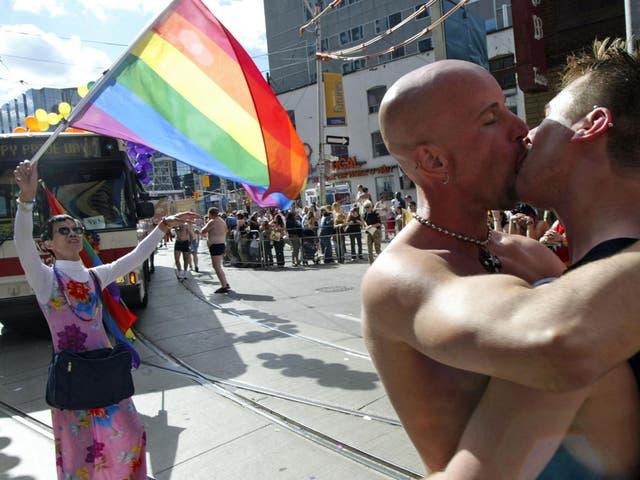 A couple kiss at Toronto's annual Pride Parade
