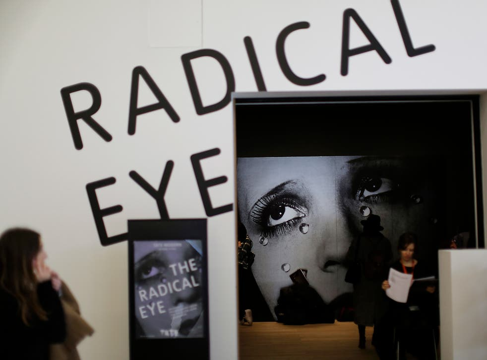 A viewer admires Sir Elton John's collection of photographs at the Tate Modern in London