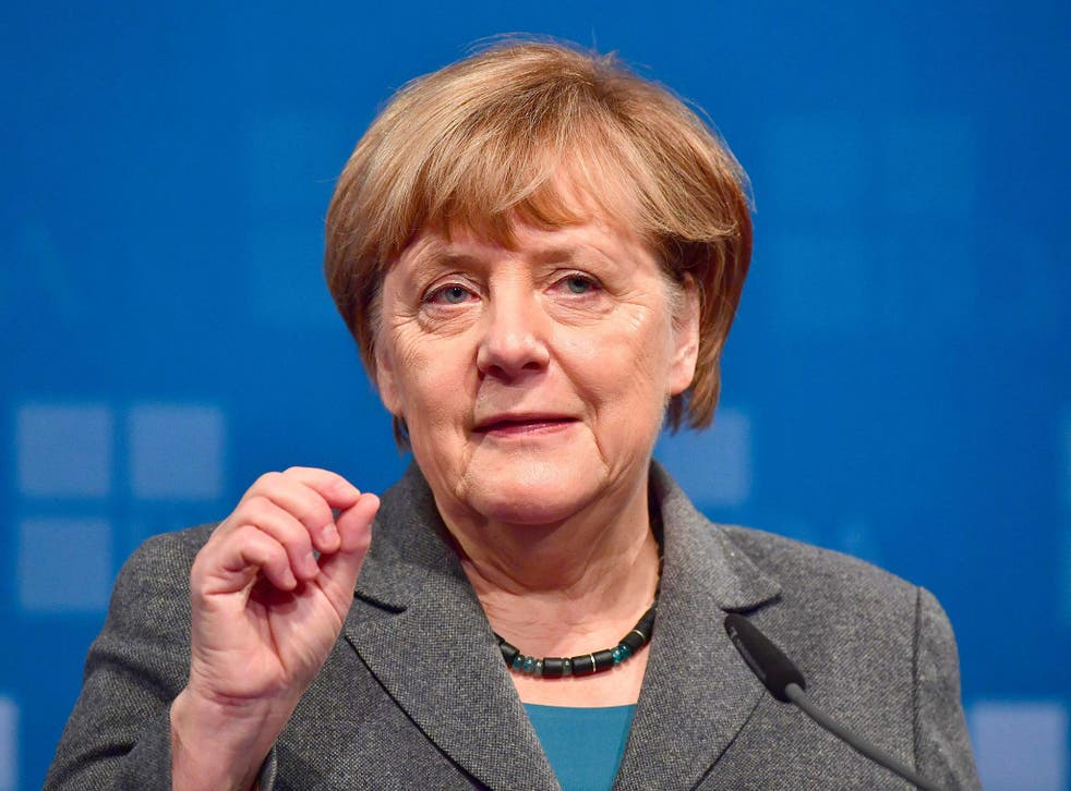German Chancellor Angela Merkel addresses guests at a meeting of the Confederation of German Employers' Associations