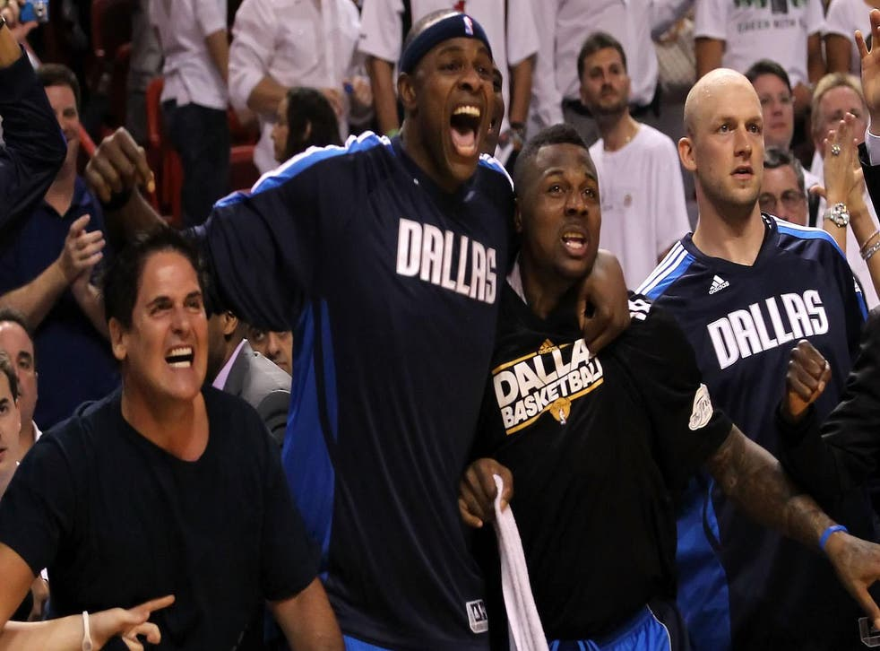 Owner Mark Cuban, Brendan Haywood #33 and DeShawn Stevenson #92 of the Dallas Mavericks react on the bench late in the fourth quarter while taking on the Miami Heat in Game Six of the 2011 NBA Finals at American Airlines Arena on June 12, 2011 in Miami, Florida.