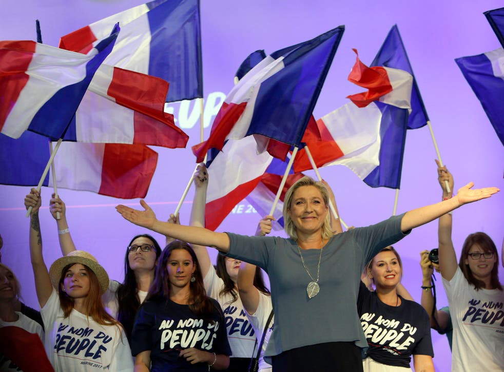 France's far-right National Front leader Marine Le Pen waves to supporters during a summer meeting in Frejus, southern France