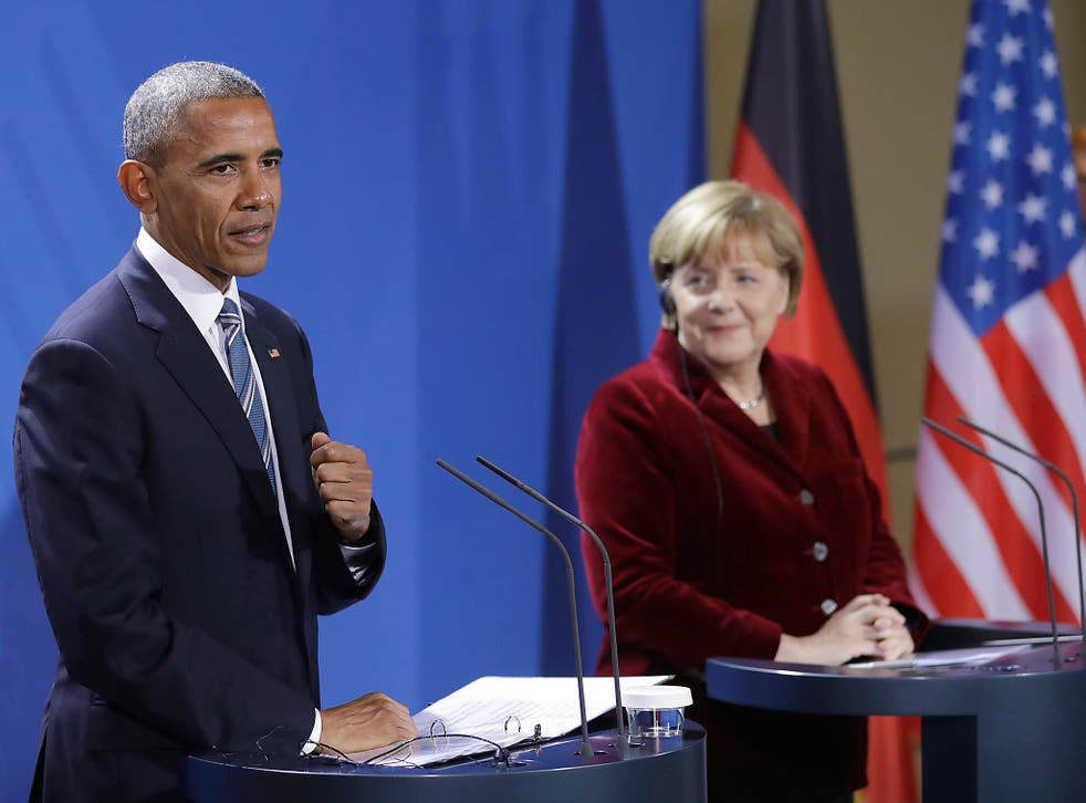 Mr Obama praised Ms Merkel as an 'outstanding partner' at their Berlin press conference, suggesting he would vote for her if he were German