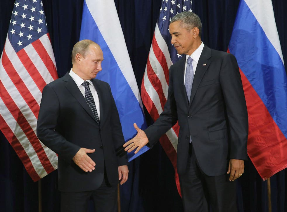 Russian President Vladimir Putin and US President Barack Obama shake hands for the cameras before the start of a bilateral meeting at the United Nations headquarters 28 September, 2015, in New York City
