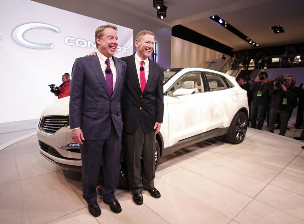 Ford Motor Company chairman Bill Ford (L) and CEO Alan Mulally (R) pose with the Lincoln MKC vehicle at a car show in 2013. Mr Ford confirmed that production of the MKC in Kentucky would not be moving to Mexico, but Donald Trump took credit for saving the entire 'Lincoln plant'.
