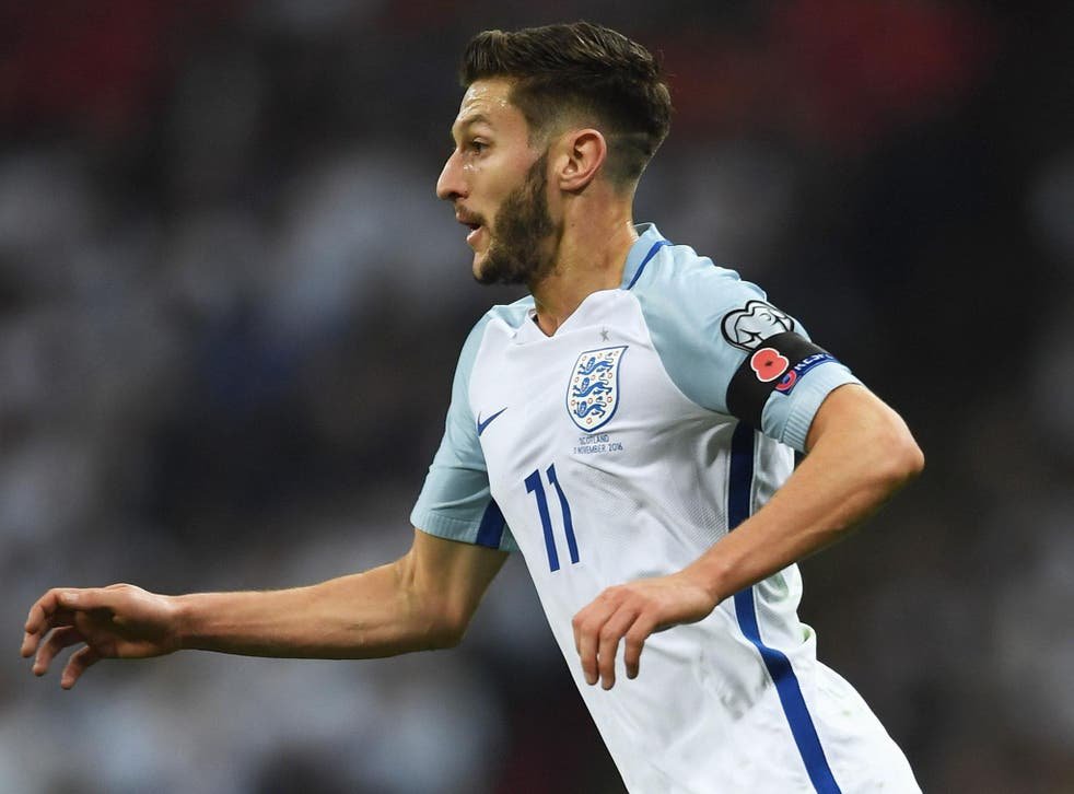 Adam Lallana sports a poppy on a black armband during England's 3-0 victory over Scotland